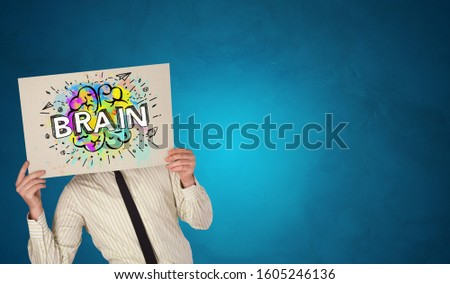 Person holding white paper in front of her head with brain concept Stock photo © ra2studio