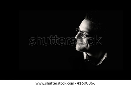 Low key portrait of attractive man looking up, black and white. Stock photo © lichtmeister