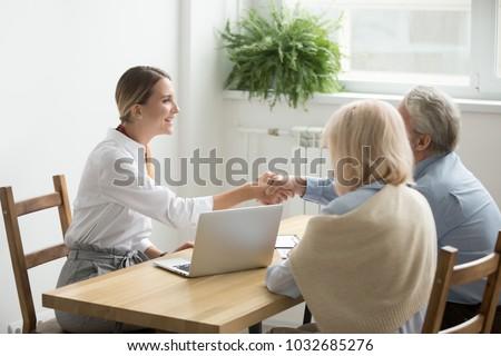 Fiatal ingatlanügynök érett pár vásárol új ház Stock fotó © pressmaster