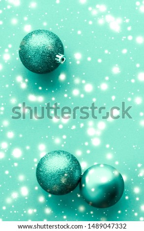 Christmas baubles on green flatlay backdrop, luxury winter holid Stock photo © Anneleven
