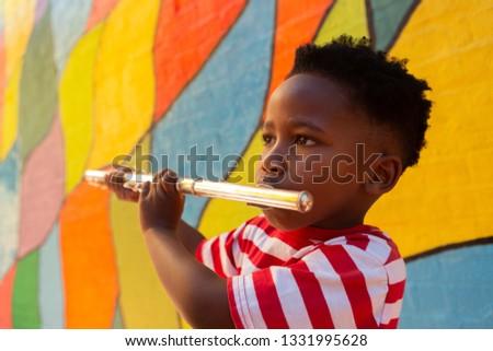 Oldalnézet ártatlan iskolás fiú játszik furulya hangszer Stock fotó © wavebreak_media