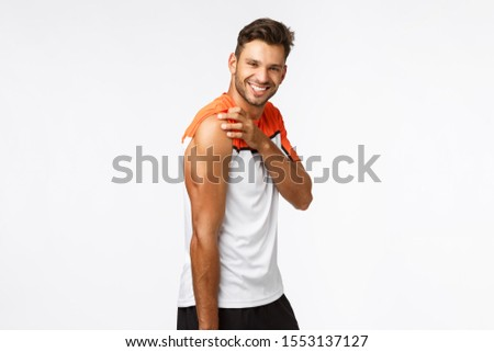Studio portrait sassy, masculine handsome sportsman in activewear raise t-shirt sleeve and tense mus Stock photo © benzoix