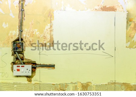 Socket and electrical wires on the wall, home renovation concept Stock photo © galitskaya