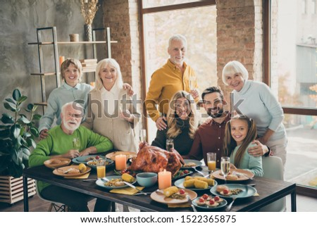 Happy mature and young family members toasting with wine over homemade food Stock photo © pressmaster