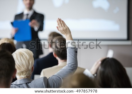 Front view of businesswoman raising hand in a business seminar in office Stock photo © wavebreak_media
