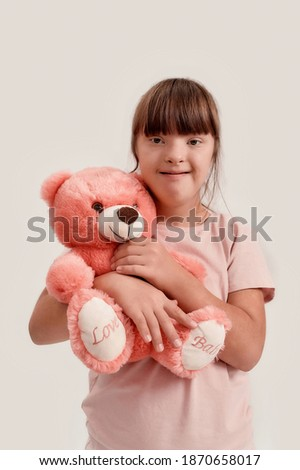 Front view of Caucasian schoolgirl looking at camera while sitting at desk in school Stock photo © wavebreak_media
