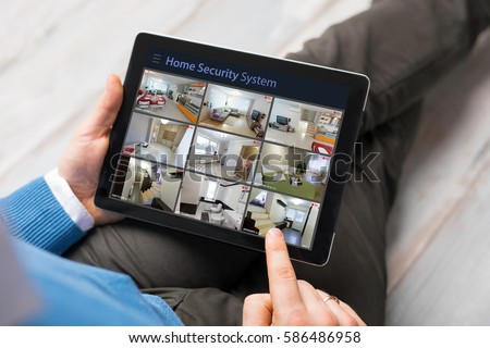 Person Holding Digital Tablet With CCTV Camera Footage On Screen Stock photo © AndreyPopov