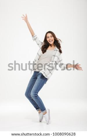 Image charmant femme danse souriant Photo stock © deandrobot