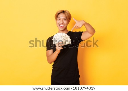 Confident good-looking guy with assertive smile, pointing fingers down to promote banner, smiling as Stock photo © benzoix