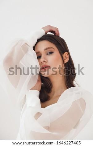 Привлекательная женщина невеста свадьба белое платье букет кирпичная стена Сток-фото © vkstudio