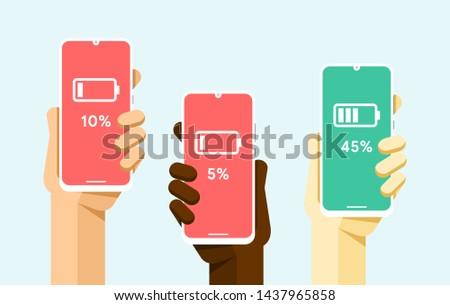 смартфон человеческая рука низкий высокий батареи Сток-фото © karetniy