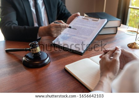 Male Notary lawyer or judge consult or discussing contract paper Stock photo © snowing