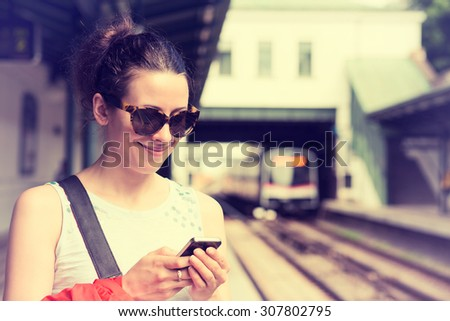 Businesswoman at train station arriving at destination leaving vehicle with hand luggage. Happy Asia Stock photo © Maridav