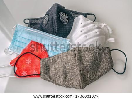 Types of masks for Coronavirus mask wearing: Different PPE protection for COVID-19 : reusable homema Stock photo © Maridav
