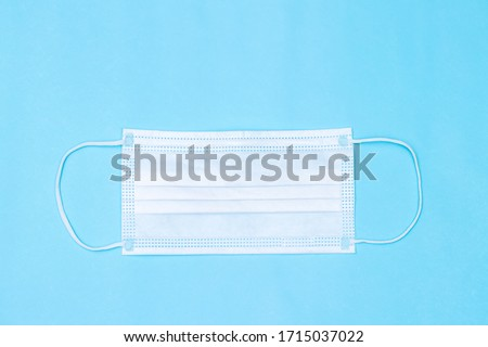 Dirty medical surgical face mask on blue background with design stains dripping concept for COVID-19 Stock photo © Maridav