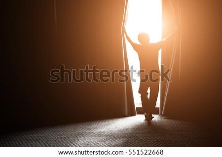 Moço abertura janela cortina casa pessoas Foto stock © dolgachov