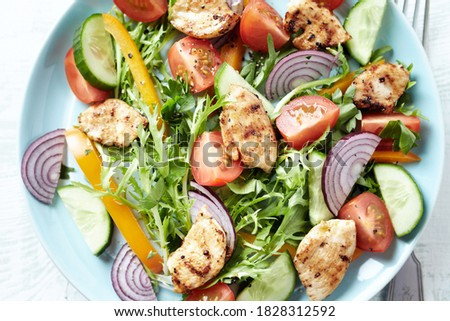 Dish of tomatoes, lettuce, cucumber, red pepper and orange slices. Stock photo © latent