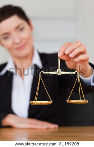 Serious businesswoman holding the justice scale with the camera focus on the object Stock photo © wavebreak_media