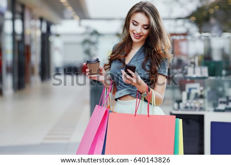 woman with beauty long brown hair wearing in red holding shoe o stock photo © victoria_andreas