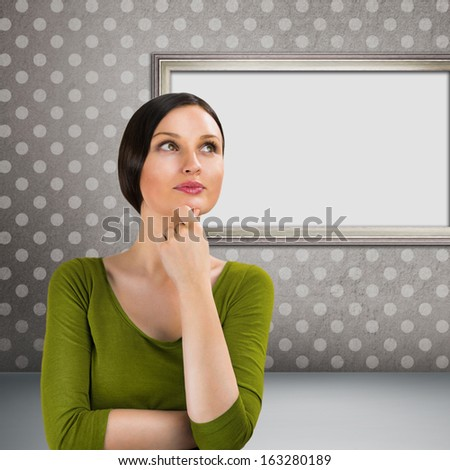 Beautiful young woman daydreaming over gray retro grunge backgro stock photo © HASLOO