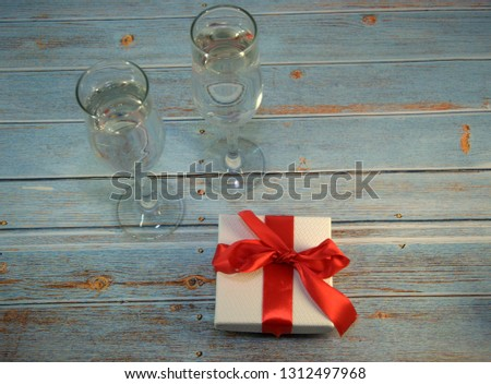 Beautiful gift in white packaging, two wineglass and red christm Stock photo © tetkoren