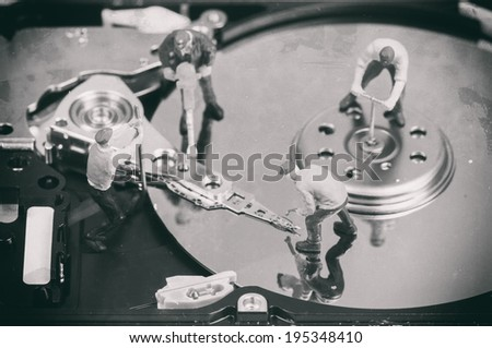 Workers repairing hard disc. Macro photo with retro style effect Stock photo © Kirill_M