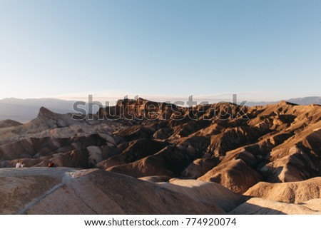 tourist watching sunset at zabriskie point death valley nationa stock photo © bmonteny