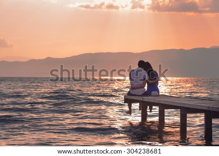 young couple embraccing over the sea on romantic travel honeymoo stock photo © victoria_andreas