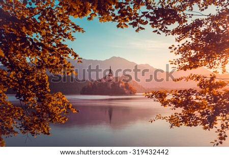 little island with church in bled lake slovenia at autumn sunri stock photo © kayco