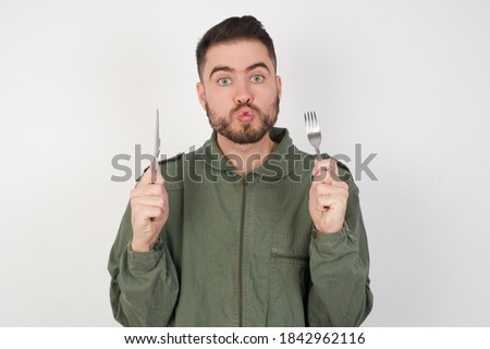 Young man in military uniform holding knife isolated on white Stock photo © Elnur