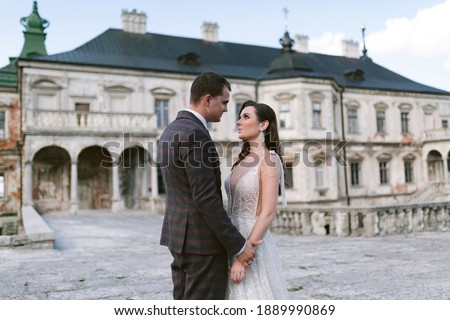 bride holds fiance for the hands against the background of the sky Stock photo © Paha_L