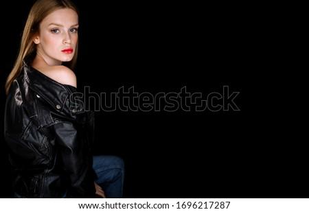 Menina jaqueta de couro posando branco estúdio retrato Foto stock © feedough