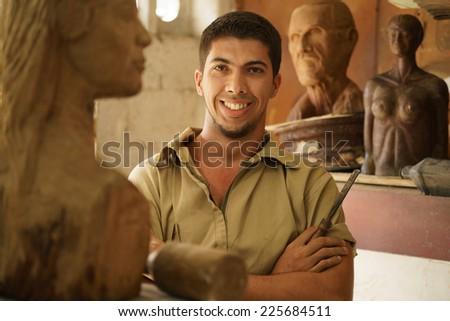 Portrait Happy Artist Man Working With Wood Sculpture In Atelier Stock photo © diego_cervo