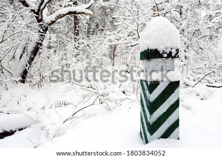 post with signs for orientation and distances in snow blizzard a Stock photo © meinzahn