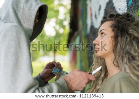 woman with mobile phone shouting and attacked by criminal man stock photo © deandrobot