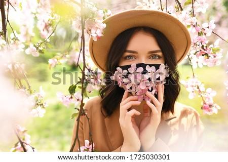 Beautiful stylish glamour woman with masking hat looking aside Stock photo © zurijeta