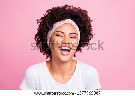 gorgeous african lady wearing white scarf laughing and touching hair stock photo © deandrobot