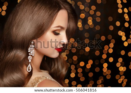Golden makeup. Elegant brunette woman. Fashion jewelry. Wavy hai Stock photo © Victoria_Andreas