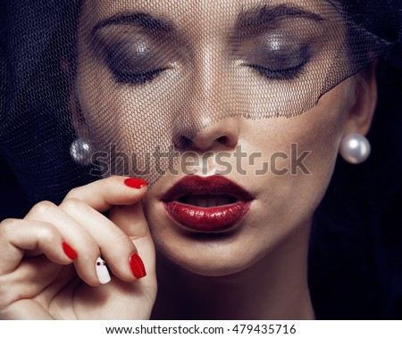 beauty brunette woman under black veil with red manicure close u stock photo © iordani