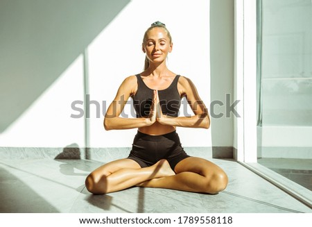Portrait of smiling woman practising yoga while sitting on sand Stock photo © wavebreak_media