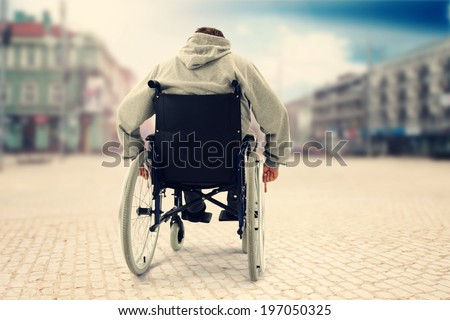 hand of young man on the wheel of wheelchair in the city park Stock photo © manaemedia