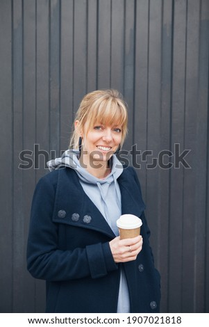 Businesswoman holding disposable cup and looking at wall with no Stock photo © wavebreak_media