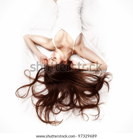 A beautiful caucasian woman lying down on the bed pretty girl us Stock photo © snowing