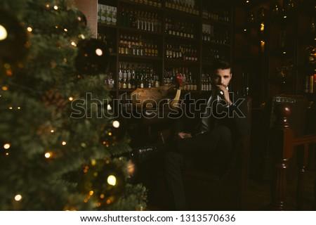 魅力的な 男 着用 黒 タキシード 座って ストックフォト © feedough