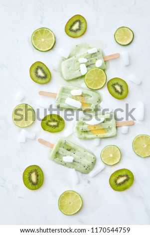 Food pattern of lime ice cream lollywith a slice of kiwi, fresh mint leaves with ice slices, lime an Stock photo © artjazz