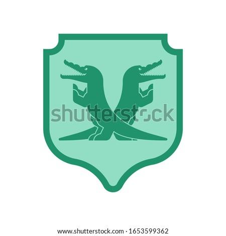 Foto stock: Crocodile And Shield Heraldic Symbol Royal Alligator For Coat O