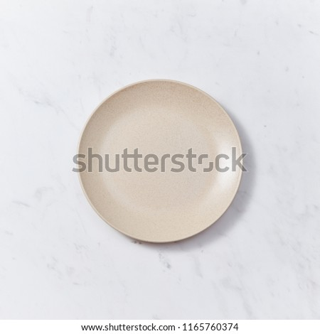 Decorative pottery - bowls, plates covered with glazed on a gray wooden background. Top view of trad Stock photo © artjazz