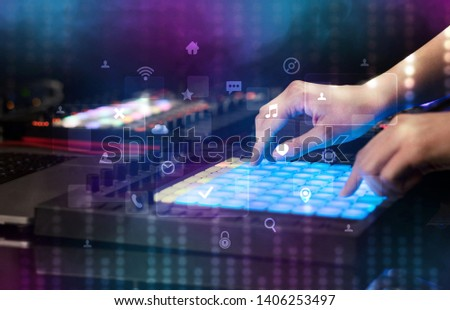 hand mixing music on midi controller with social media concept stock photo © ra2studio