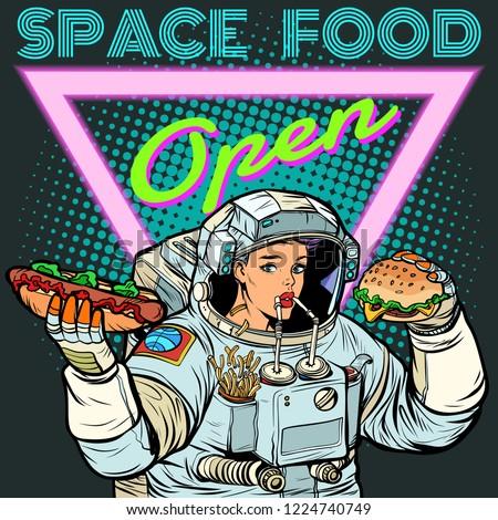 Pop art. Woman astronaut eats. Cola, hot dog and Burger fast foo Stock photo © studiostoks