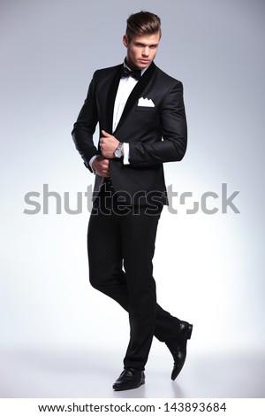 confident businessman in black tuxedo standing with legs crossed Stock photo © feedough